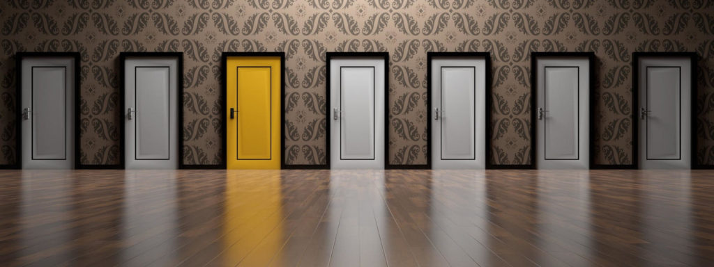 Photo of multiple doors, one yellow, the rest white