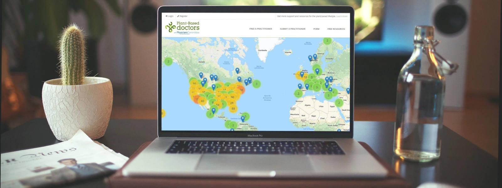 Laptop screen showcasing Plant-Based Doctors Directory website